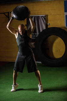 Thai boxer lifting weight