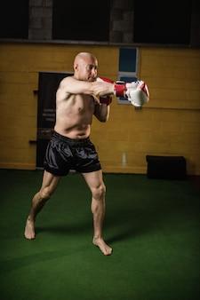 Thai boxer practicing boxing