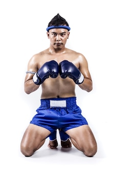 Thai boxer with thai boxing action, isolated on white background