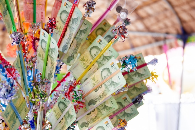 Thai buddhist make a merit with bank note in songkran festival.  songkran festival is the traditional new year celebration in thailand.