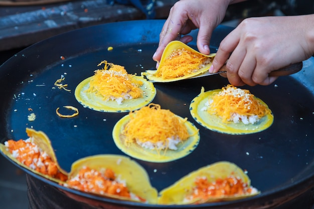 Thai crispy pancake or thai crepe, with filling sweet white custard cream and golden sweet egg floss