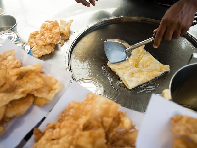 Thai crispy roti street food cart vendor.