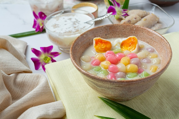 Thai dessert called bualoy balls in dippers with hot coconut milk and pandan leaves to increase the deliciousness.
