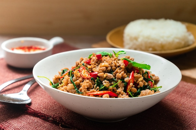 Thai famous food   stirfried basil with minced pork hot and spicy taste serving with jasmine rice and fish sauce