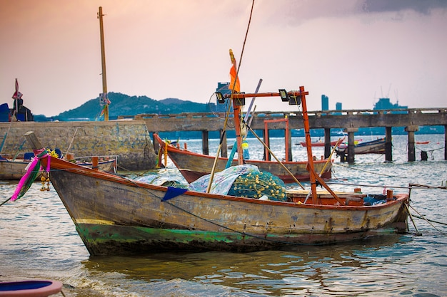 Thai folk fishery boat on port in the sea, near jetty. fisheries concept.