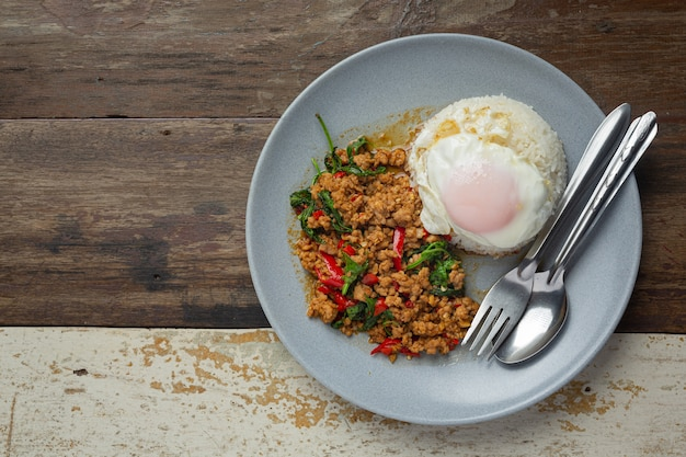 Thai food. basil minced pork with rice and  fried egg