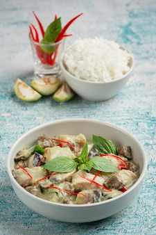 Thai food. green coconut curry pork with eggplants