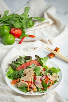 Thai food ;mixed spicy white pork sausage salad or yum moo yor