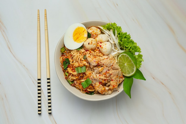 Thai food. noodles spicy boil with pork and boil egg