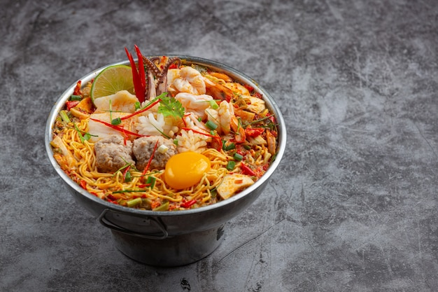 Thai food. noodles spicy boil with seafood and pork in hot pot