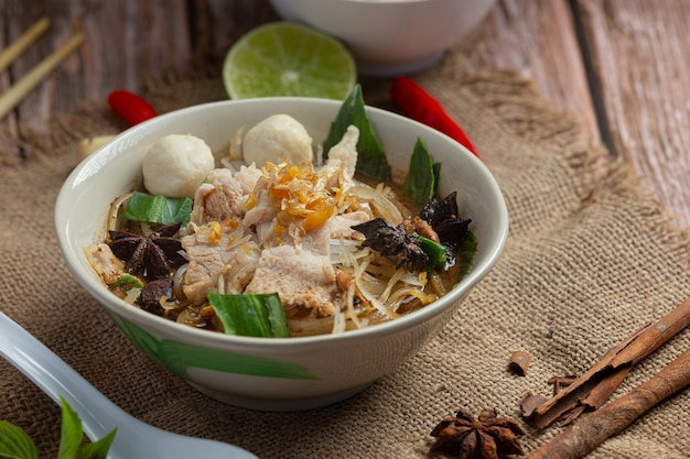 Thai food noodles with pork, meatball and vegetable