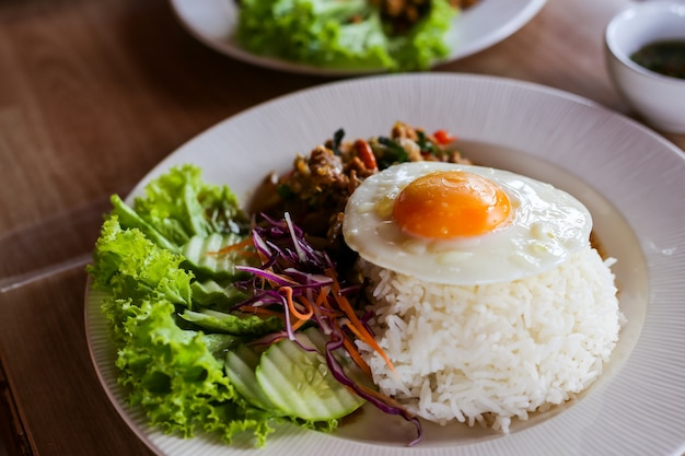 Thai food, pad ka phrao, fried meat with chili, garlic and holy basil. eat with rice and f