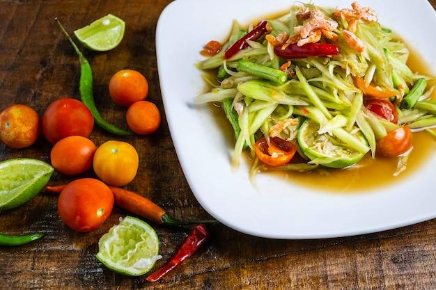 Thai food  papaya salad on a wooden table