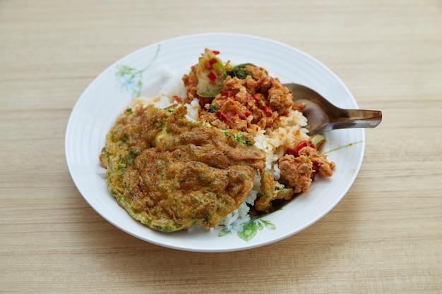 Thai food rice stir fried red curry  pork