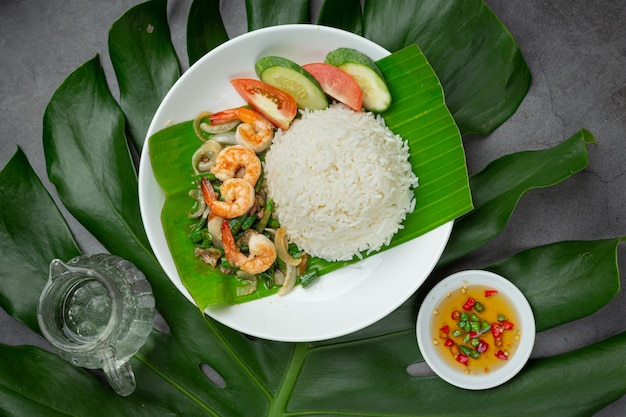Thai food; shrimp and squid fried cooked with long beans and rice.