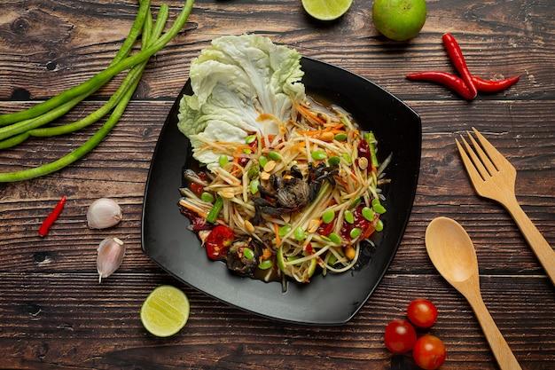 Cibo tailandese; som tum o insalata di papaya