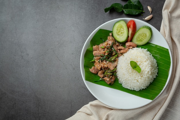 Thai food ;stir-fried pork with kaffir lime leaves serve with rice