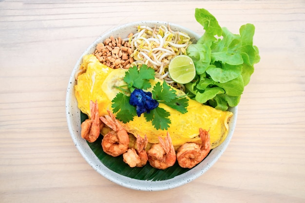Thai food, top view of pad thai wrapped in omelette