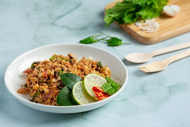 Thai food with spicy minced pork serve with side dishes