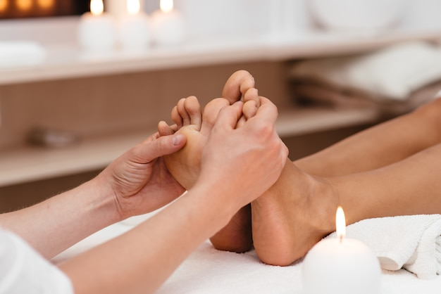 Thai foot massage series in spa salon.