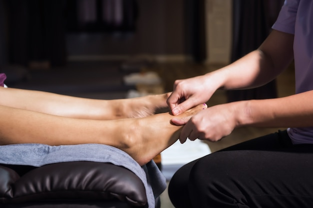 Thai foot massage in spa salon