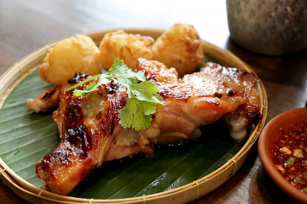 Thai grilled chicken with fried sticky rice mix egg and spicy thai sauce style