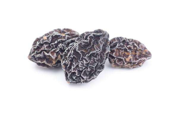 Thai herb name terminalia chebula retz. or  myrobalan wood isolated on white background.