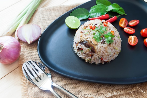 Thai mackerel fried rice with herbs. traditional spicy fried rice. close up
