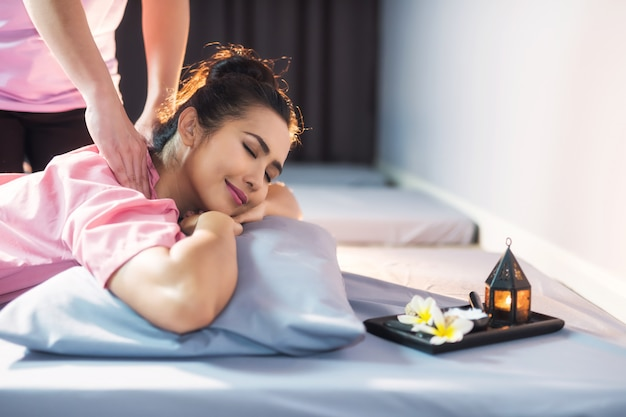 Thai massage on a bed in spa