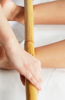 Thai massage with bamboo stick