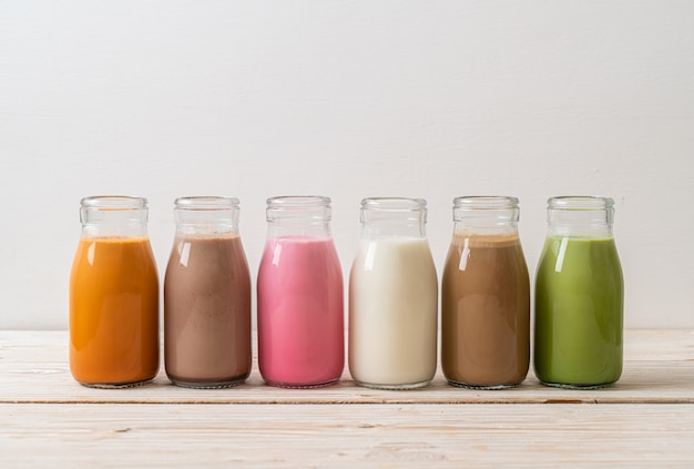 Thai milk tea, matcha green tea latte, coffee, chocolate milk, pink milk and fresh milk in bottle
