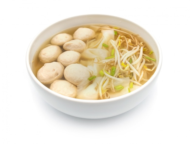 Thai noodle and meatball in the bamboo bowl isolate on the white background