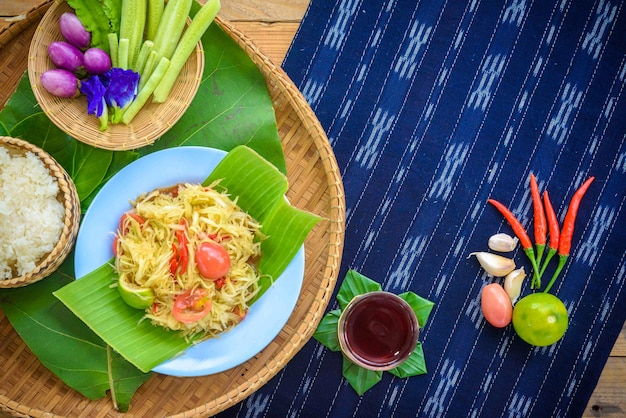 Thai northeast food called som tam or papaya salad with side dishes