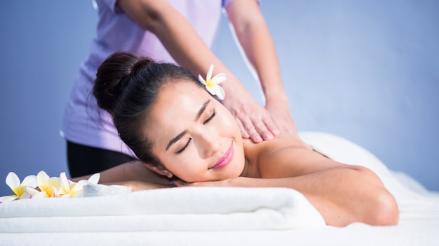 Thai oil back spiral and shoulder massage to young asian beautiful woman