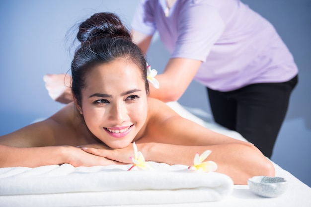 Thai oil massage to attractive woman