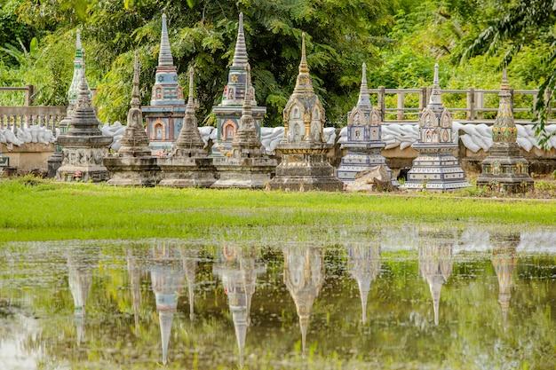 Thai old pagoda water reflection