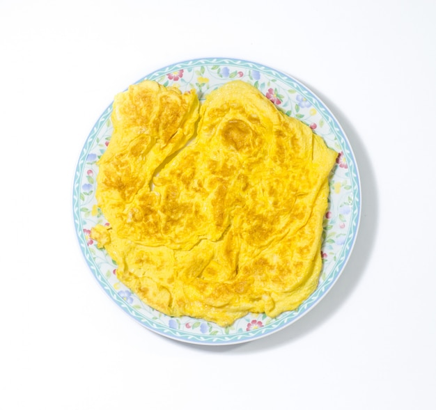 Thai omelette style in the dish isoleted on white background