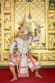 Thai pantomime dance scene hanuman is standing with the weapons in ready position.