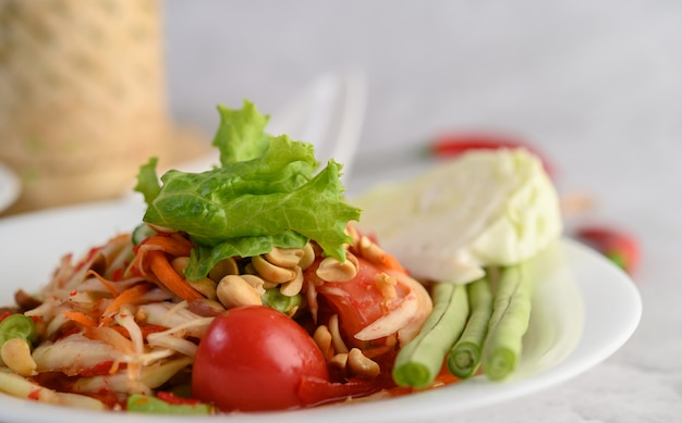 Thai papaya salad in a white plate