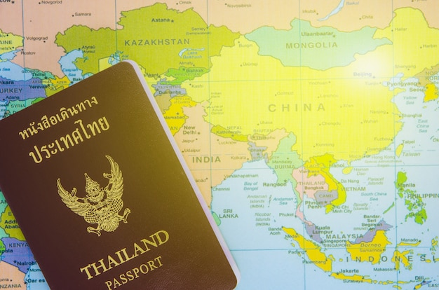 Thai passport lay on asia map