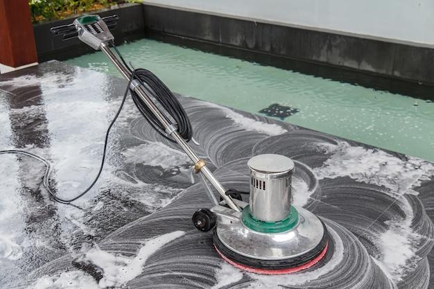 Thai people cleaning black granite floor