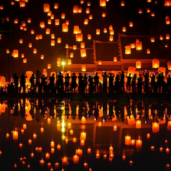 Thai people floating sky lantern in northern thai traditional new year