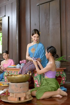 Thai people make thai dessert in thai period costume