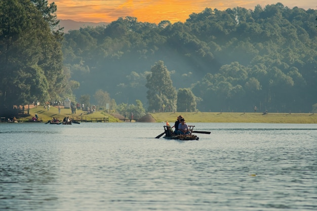 Thai people and travelers foreign travel visit rowing bamboo rafts in pang ung lake tour pang oung