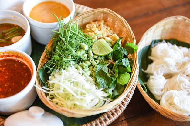 Thai rice vermicelli noodle with soup curry sauce and fresh vegetable set - thai traditional menu