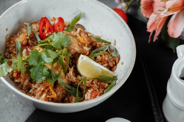 Thai rice with chicken and vegetables. place for inscription.