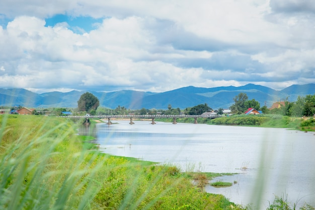 Thai rural countryside beautiful landscape of river mountain blue sky and cloud