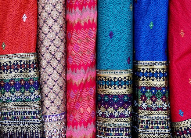 Thai silk fabric row background.closeup