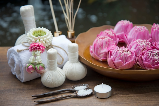 Thai spa massage treatment and product for healthy women with lotus flower.  thailand