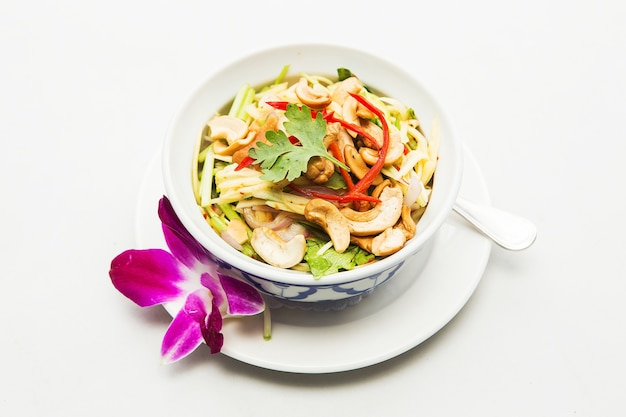 Thai spicy mango salad with spicy sauce